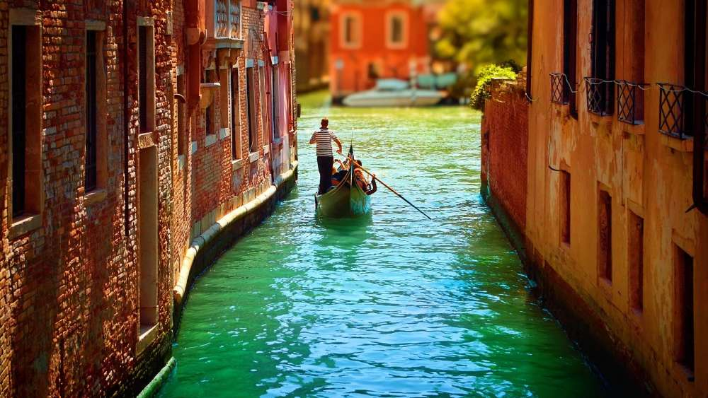 Romantic gondola floating on the canal wallpaper