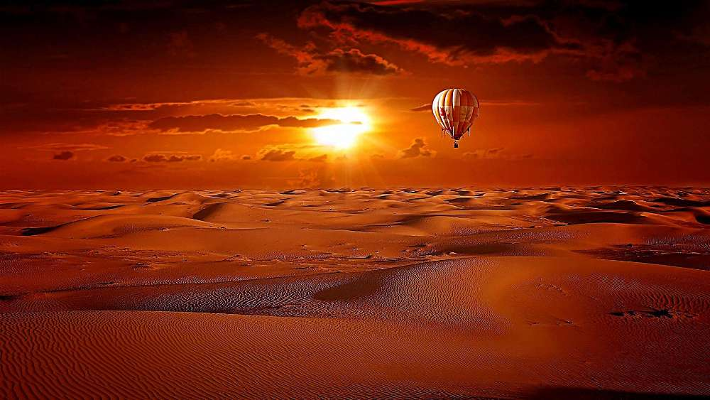 Hot air balloon above the desert in the sunrise wallpaper