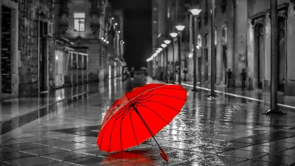 Red umbrella on the rainy street wallpaper
