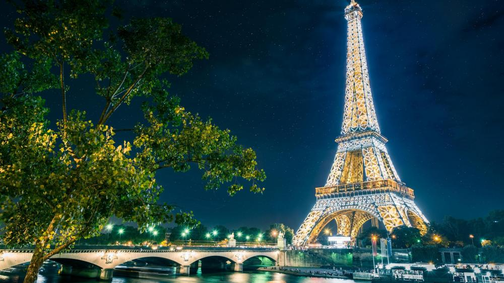 Paris at night - Starry night sky above the Eiffel Tower  wallpaper