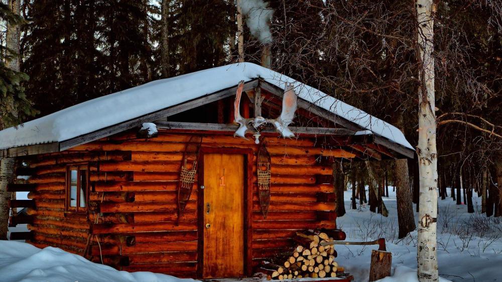Winter log cabin in Alaska wallpaper