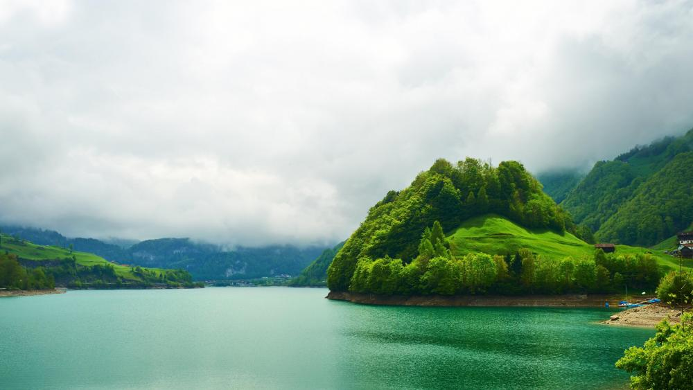 Emerald Mountain Lake in Lungern, Switzerland wallpaper