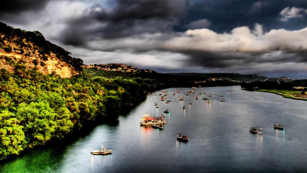 River boats under the cludy sky wallpaper