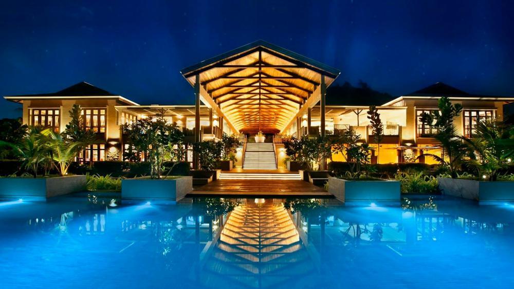 Fascinating swimming pool at night - Seychelles wallpaper