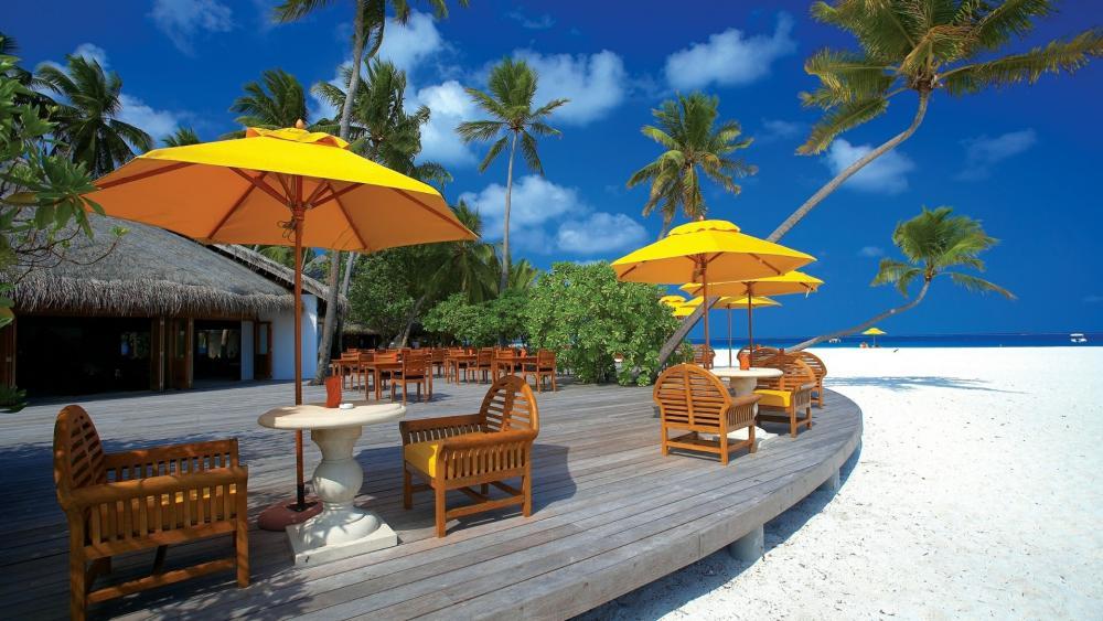 Yellow parasols in the beach - Maldives wallpaper