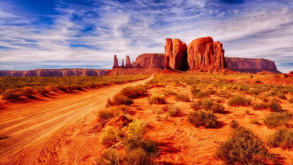 Dirt road in Monument Valley - Navajo Tribal Park wallpaper