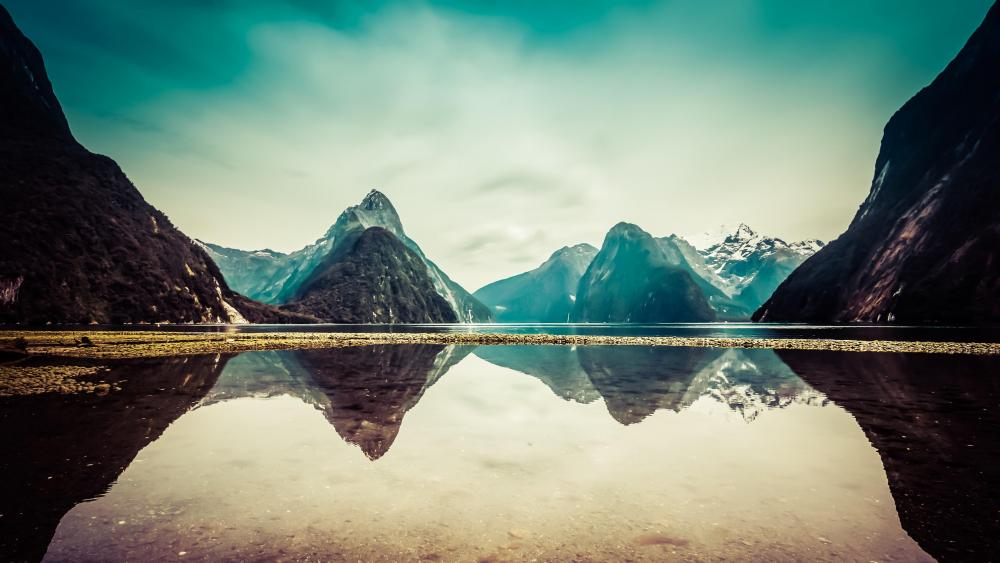 Milford Sound reflection in the morning sunlight, Fiordland National Park, New Zealand wallpaper