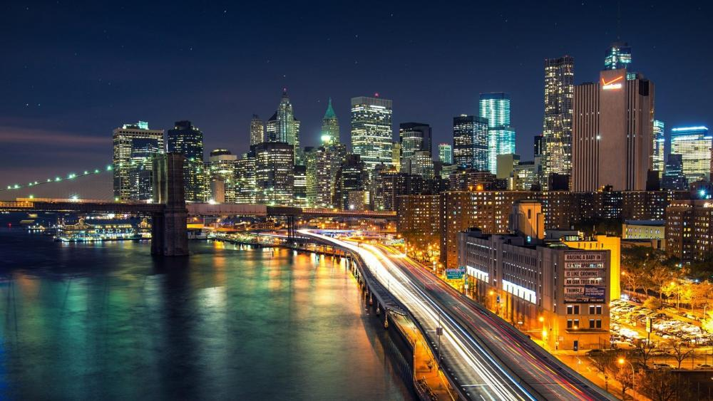 New York city lights at night from the East River wallpaper