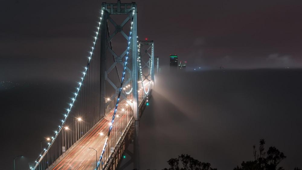 The misty San Francisco–Oakland Bay Bridge at night wallpaper