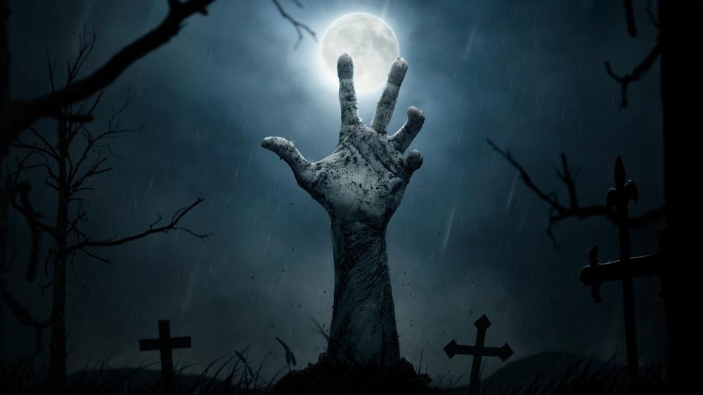 Creepy night cemetery with a zombie hand wallpaper