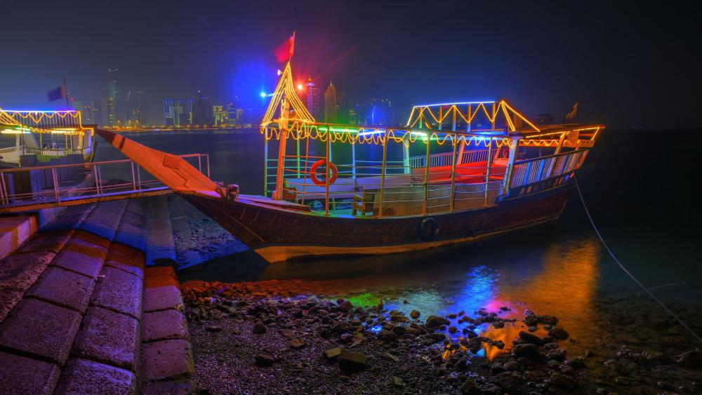 Colorful illuminated dhow boat at night - Doha, Qatar wallpaper