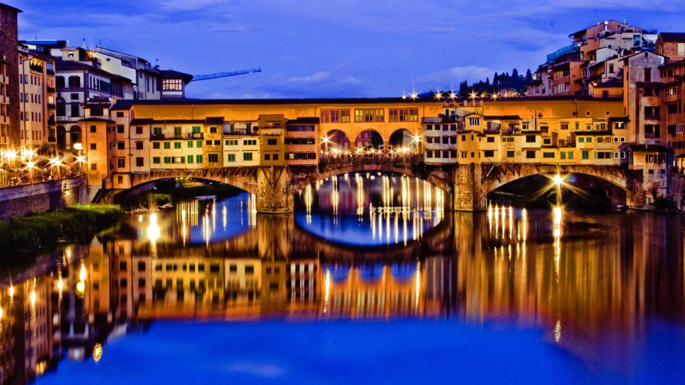 Ponte Vecchio Bridge and the Arno River at dusk wallpaper