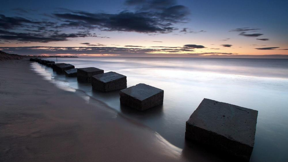 Stone cubes in the shore wallpaper