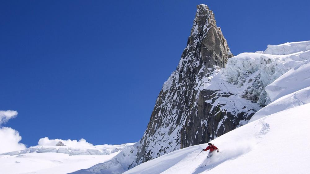Skiing in the mountainside wallpaper