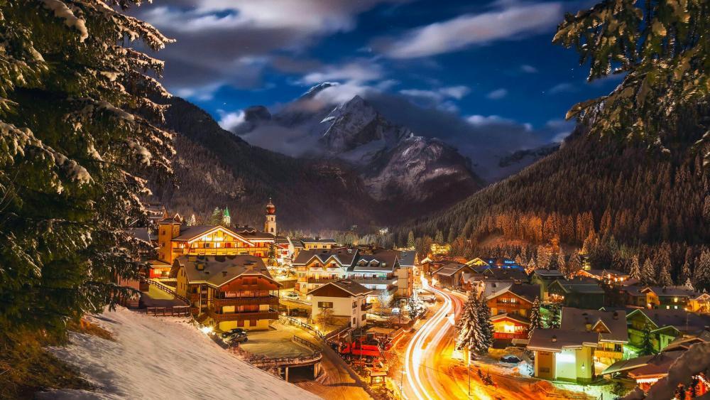Canazei ski resort on a winter evening - Italy wallpaper