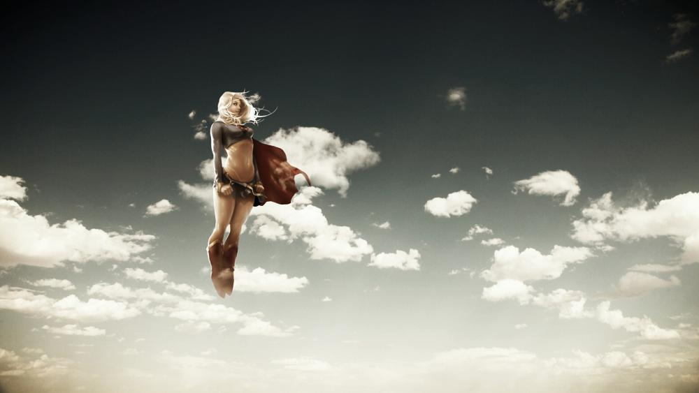 Supergirl flying on the sky wallpaper