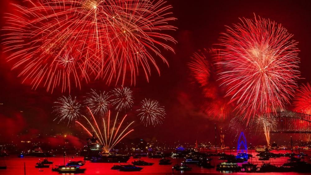 Red fireworks over the bay wallpaper