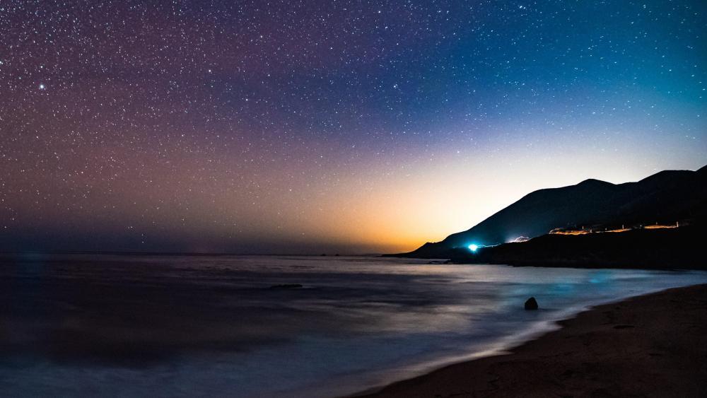 Starry seashore sky wallpaper