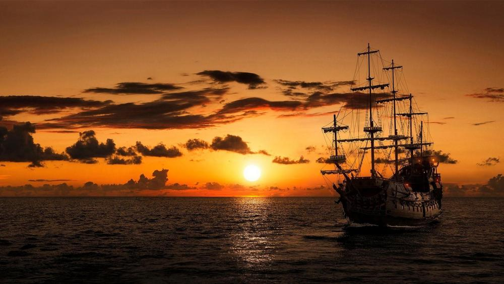Pirate ship in the sunset wallpaper