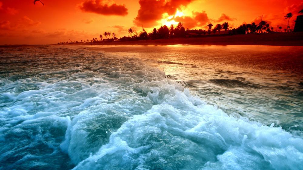 Foamy waves in the sunset wallpaper