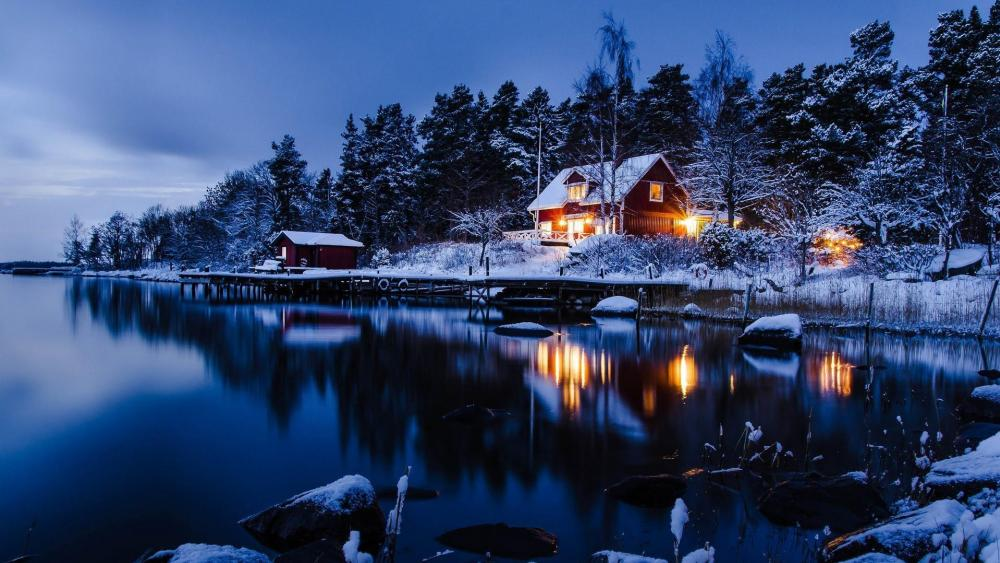 Snow covered cabin in Sweden wallpaper