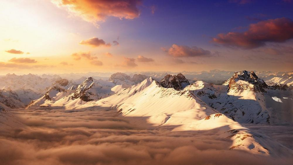 Mountain peaks above the clouds wallpaper