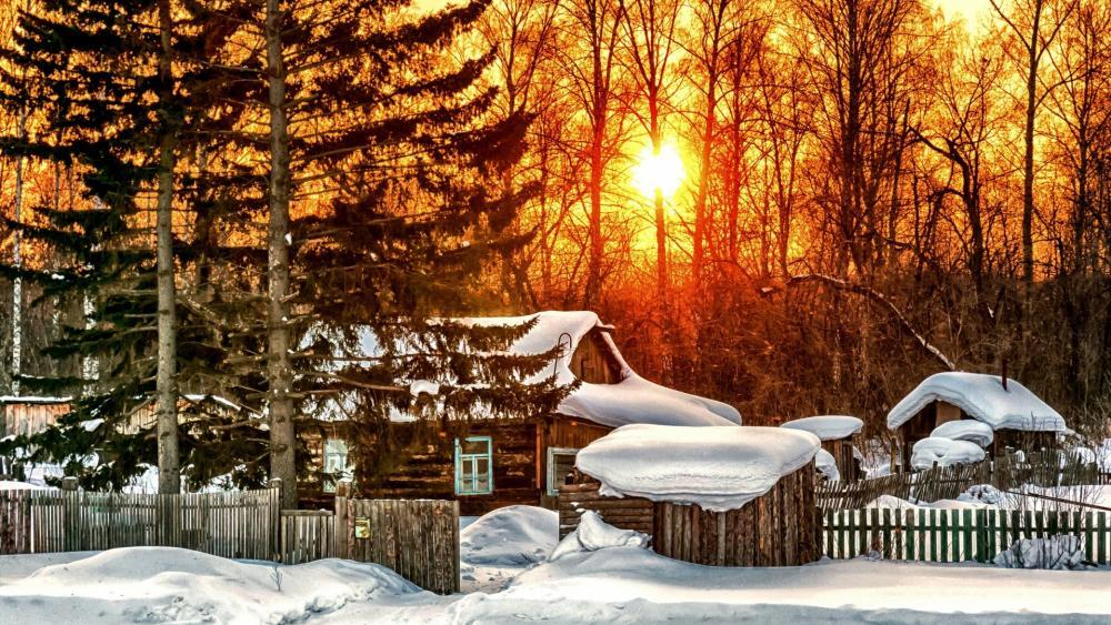 Snowy log cabin wallpaper