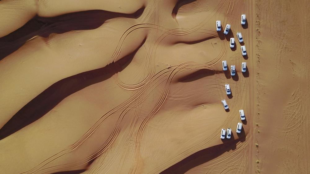 Car team in desert wallpaper