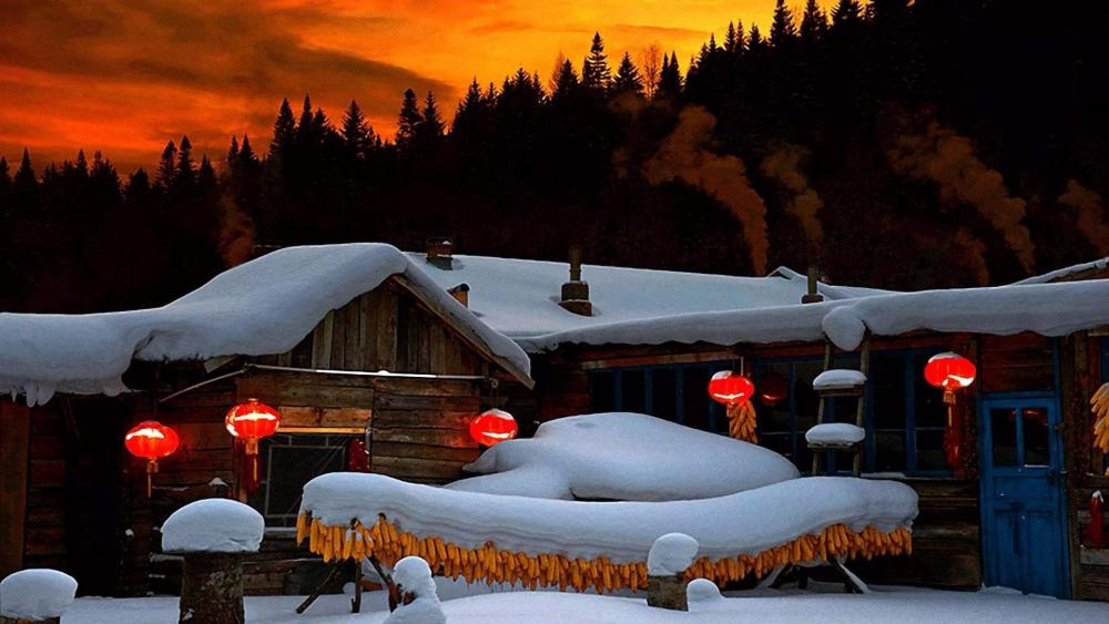 Snowy countryside sunset wallpaper
