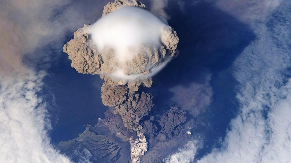 Aerial view volcano eruption steam wallpaper