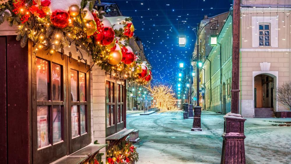 Snowy street at Chrismas in Moscow wallpaper