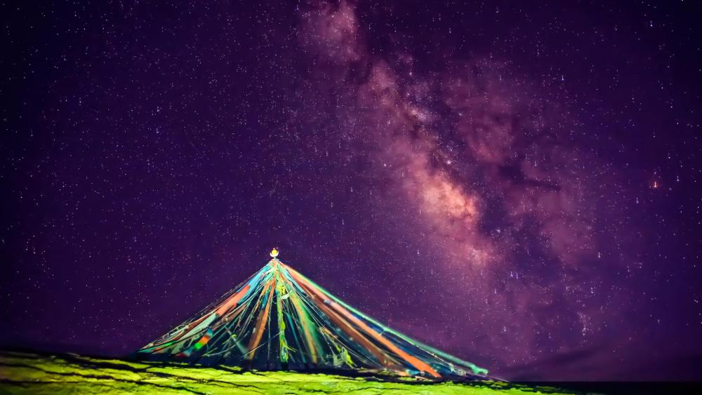Prayer flags pile with the Milky Way wallpaper