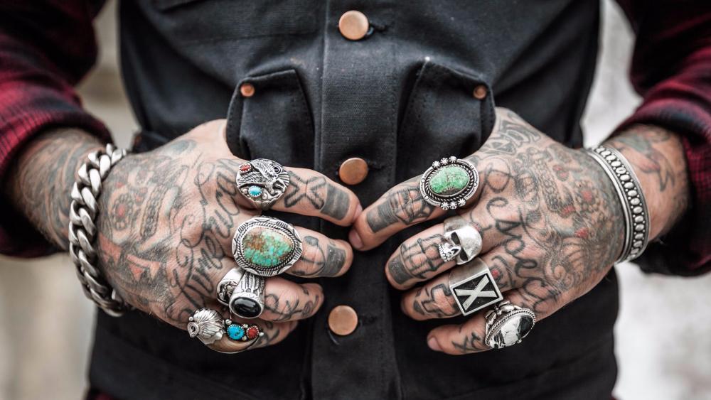 Tattooed hands wallpaper