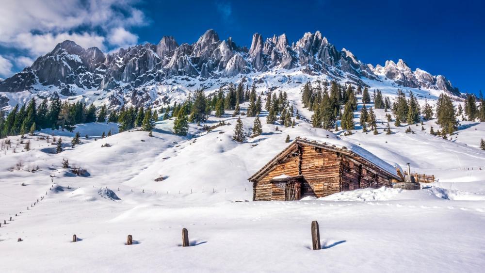 Snowy log cabin in Dolomites wallpaper