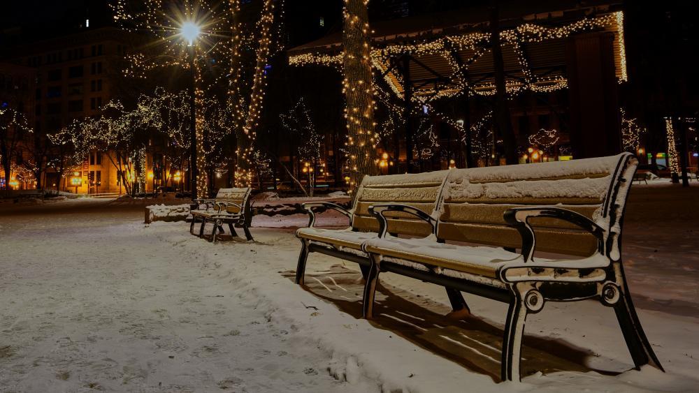 Snowy bench at Christmas season wallpaper