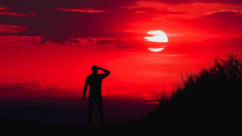 Man silhouette in the ablaze sunset wallpaper