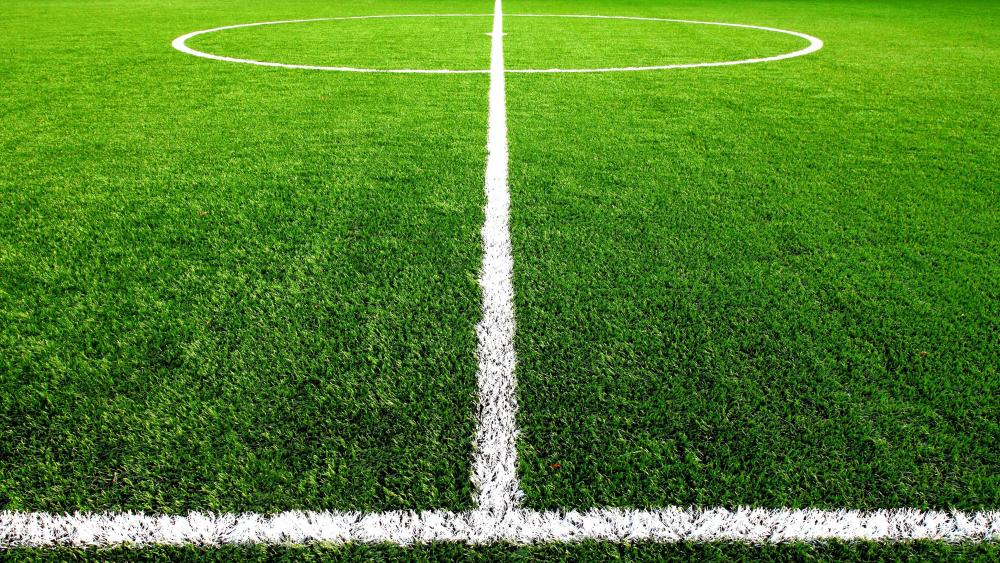 Artificial grass with white lines for football field wallpaper
