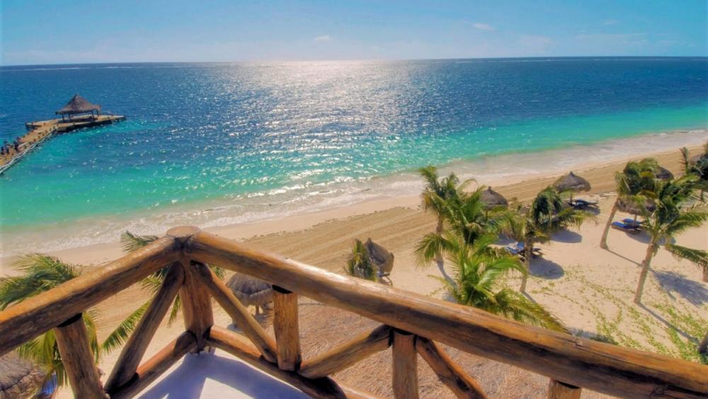 Sandy beach in Puerto Morelos, Mexico wallpaper