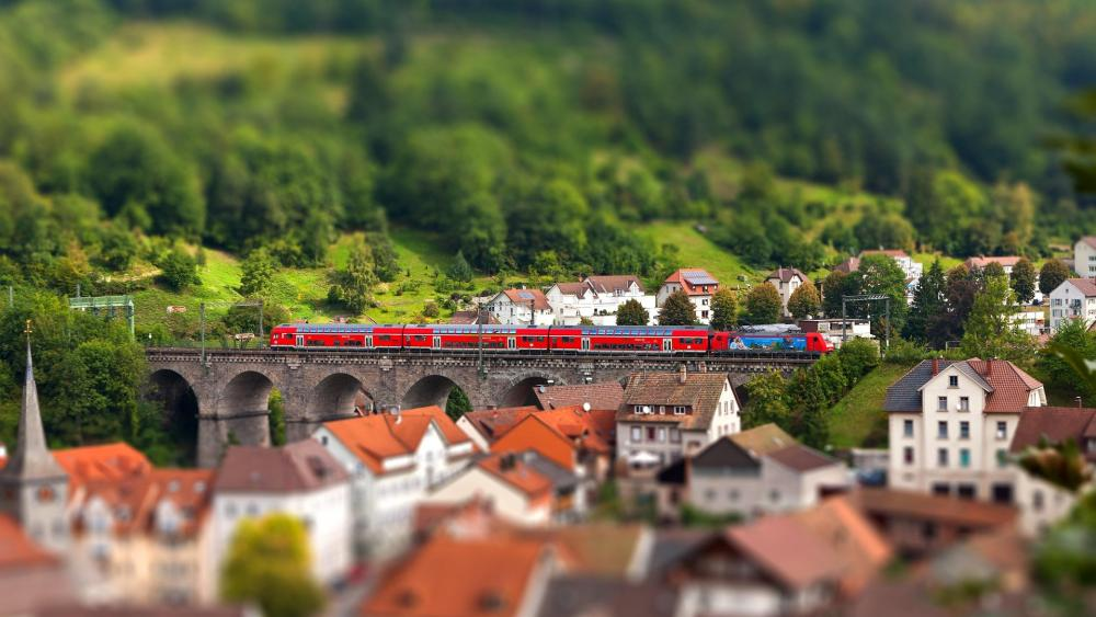 The train passed through the town - Tilt-shift photography wallpaper