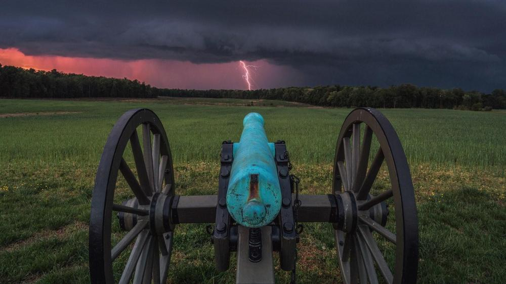 Old Cannon in the lightning storm wallpaper