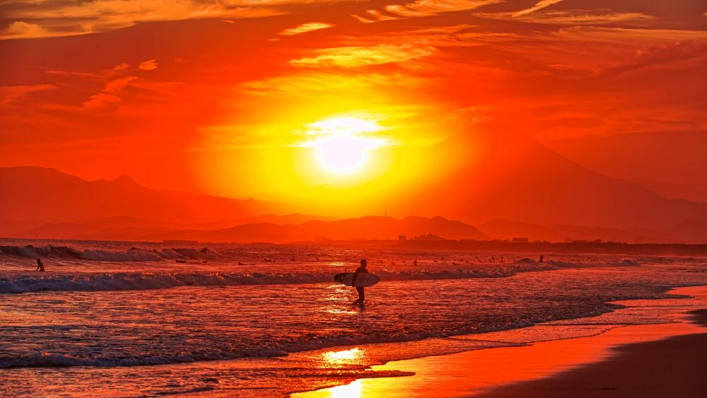 Surfers in the sunset wallpaper