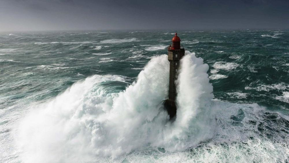 The Lighthouse of La Jument during storm wallpaper