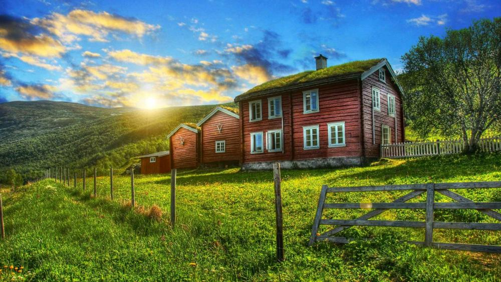Country house with grass roof wallpaper