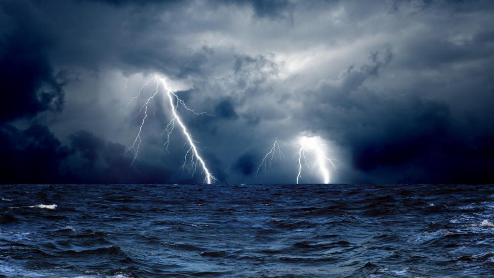 Lightning strikes over the ocean wallpaper
