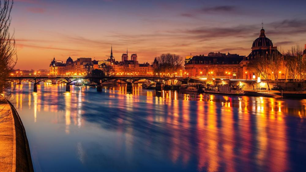 Old Town of Paris and Seine river in the sunrise wallpaper