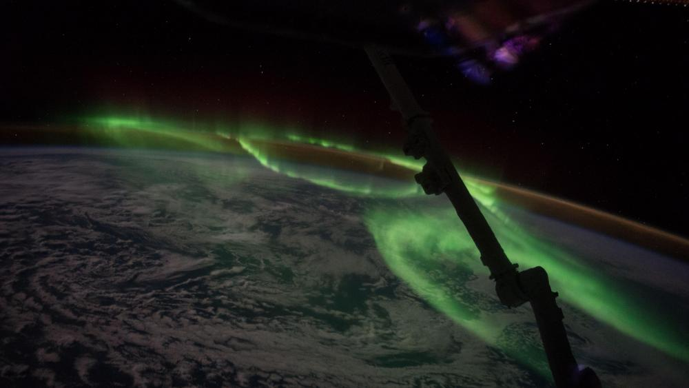 Polar lights (Aurora Australis) from the space wallpaper