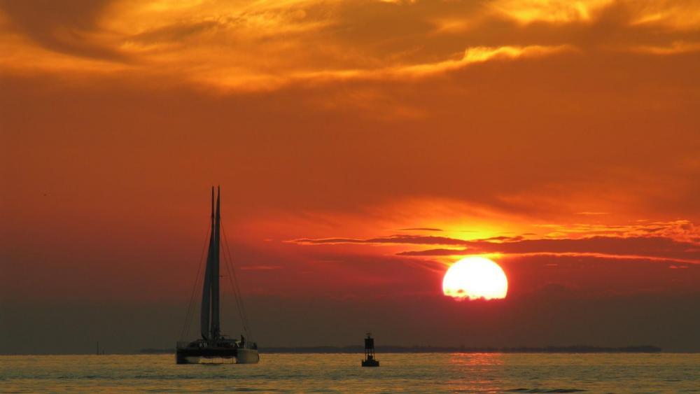 Sailboat in the sundown wallpaper