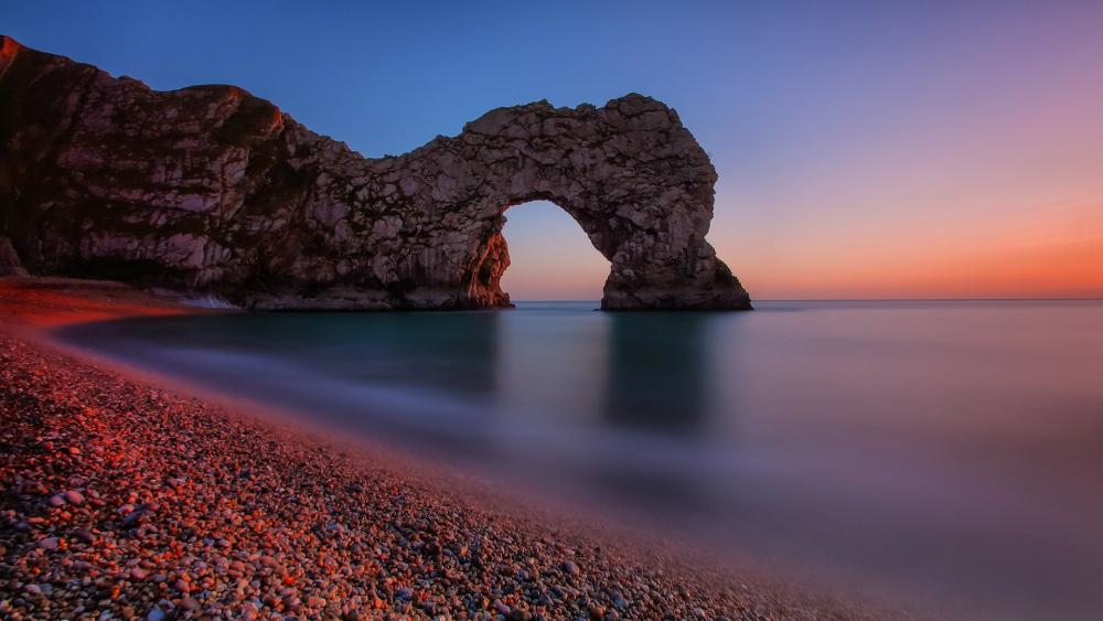 Durdle Door natural rock arch at sunset (Jurassic Coast, England) wallpaper