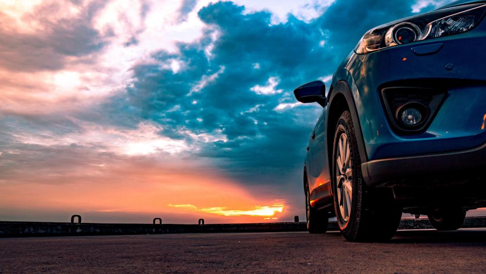 Sports car at sunset wallpaper