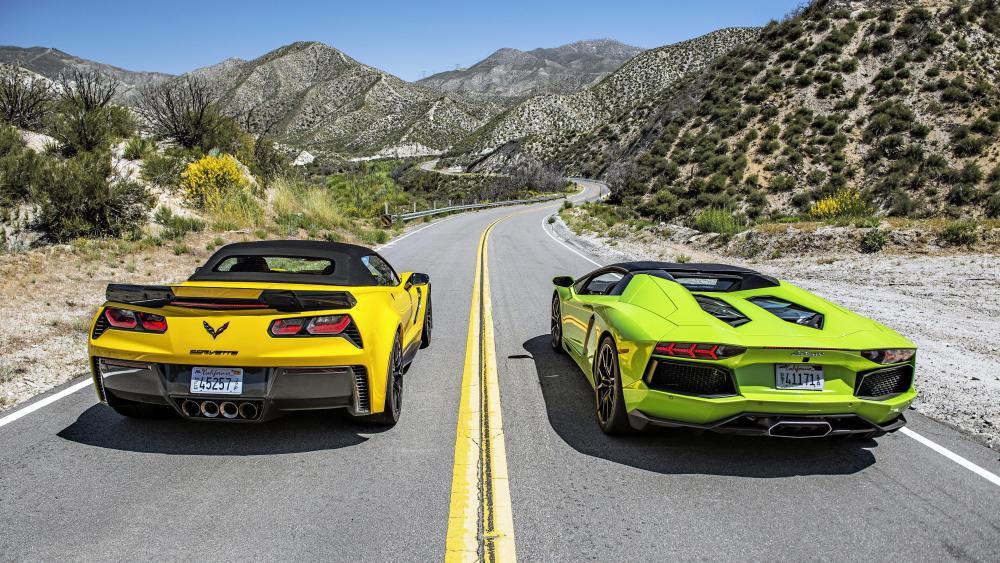 Green Lamborghini Aventador roadster VS yellow Chevrolet Corvette wallpaper